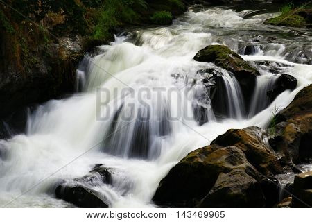 a picture of an exterior Pacific Northwest waterfall