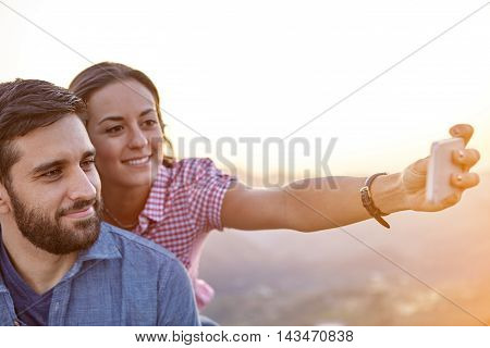 Happy Young Couple Smiling For A Selfie