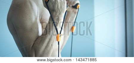 Man Exercising With Exercise Bands