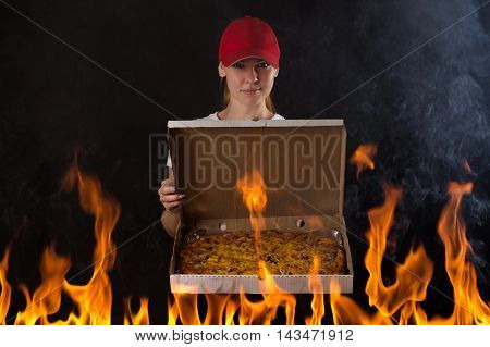 young girl with pizza box on fire