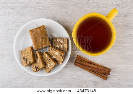 Pieces Of Sherbet, Cup Of Tea And Cinnamon Sticks