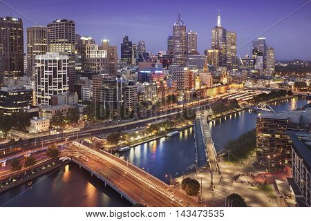 Melbourne city skyline and Yarra River at twilight.