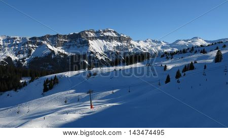 Ski slopes cable car and mountains. Winter scene in Flumserberg Switzerland.