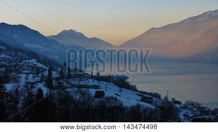 Sunset in Unterterzen. Lake Walensee Switzerland. Winter scene.