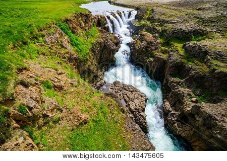 View of waterfall of Kolugljufur in north Iceland from a bridge
