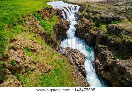 View of waterfall of Kolugljufur in north Iceland from a bridge