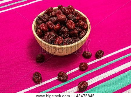 diet supplements - dried cranberries on canvas