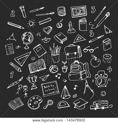 School background with hand drawn school supplies. Back to school. Freehand drawing school items on blackboard.