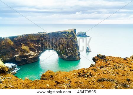 Natural Arch the rock formation at the cape Dyrholaey near the village of Vik In Iceland