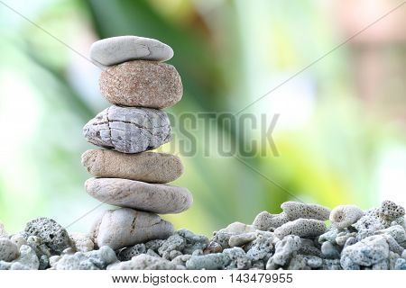 Balance stone on pile rock with garden background for concept of Zen and spa.