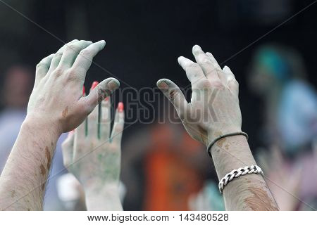STOCKHOLM SWEDEN - MAY 22 2016: Closeup of hands and color powder in the air in the air in the Color Run Event in Sweden May 22 2016