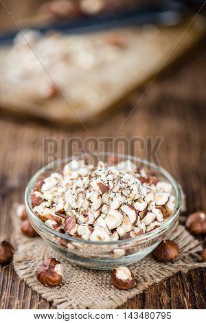 Some Chopped Hazelnuts On Wooden Background