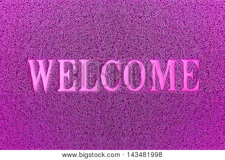 Welcome Purple Door Mat. Welcome Carpet Background. Welcome Purple Sign.