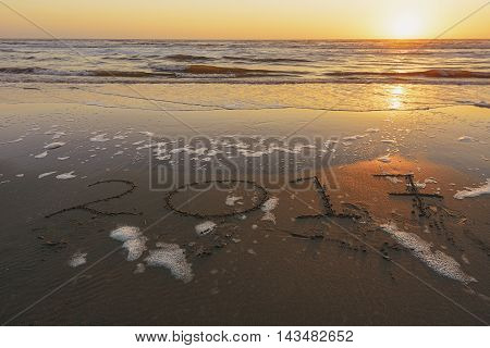 2017 inscription on the sand of evening beach.