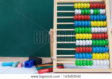Decoration made of table abacus and school supplies.Back to school theme.