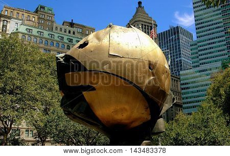 New York City - August 22 2004: The Orb by sculptor Fritz Koenig which survived the 9-11 terror attacks relocated in Battery Park