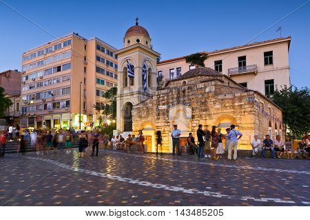 ATHENS, GREECE - AUGUST 20, 2016: People at an old church in Monastiraki square in central Athens on August 20, 2016.
