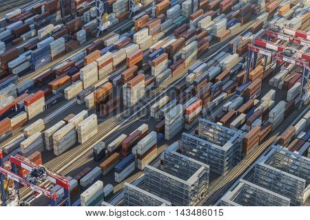 Los Angeles, California, USA - August 16, 2016:  Afternoon aerial view of cargo shipping containers stacked on docks.