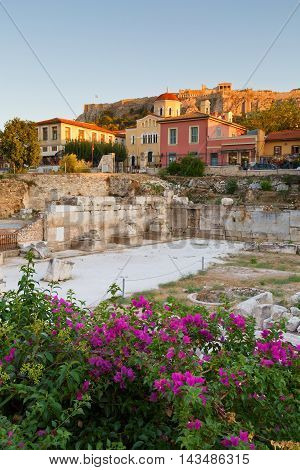 Remains of Hadrian's Library, Plaka and Acropolis on a summer evening.