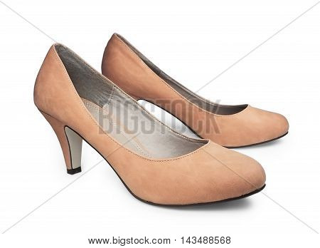 Nude colored pump shoes, isolated on white background.