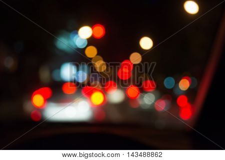 Blur Image Of People Driving Car On Night Time .