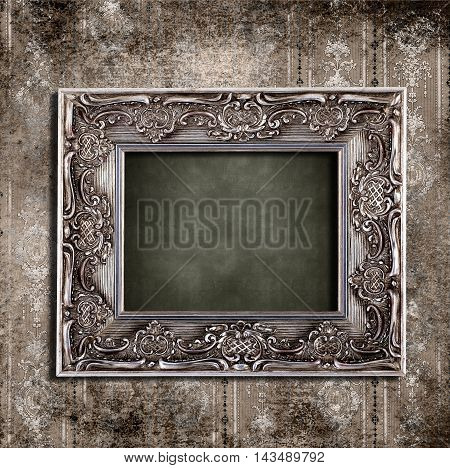 Old room with empty picture frame. Vintage frame.