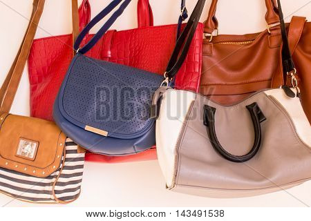 Many color women bags on white background