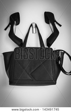 Black sexy shoes and bag on white background