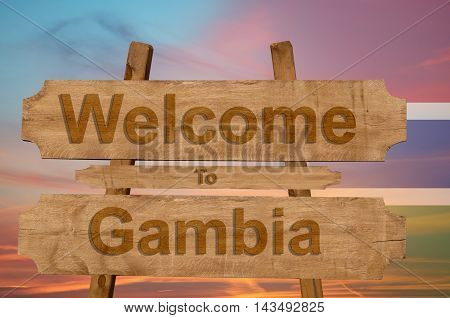 Welcome To Gambia Sing On Wood Background With Blending National Flag