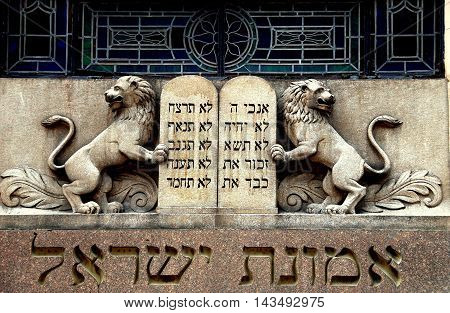 New York City - July 17 2009: Lions of Judah flank Ten Commandments tablets above the entrance to Congregation Eumanath Israel on West 23rd Street in Chelsea