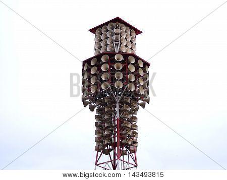 Loudspeaker or Megaphone broadcasting pillar outdoor on white sky