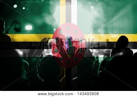live music concert with blending Dominica flag on fans