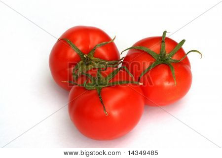 Three red tomatoes, isolated on white