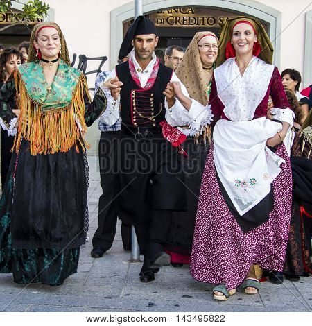 QUARTU S.E., ITALY - September 15, 2012: Parade of the 2012 Wine Festival - Sardinia - group of people in Sardinian costumes who perform a traditional dance