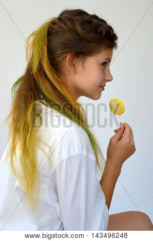 Girl  with colored strands and with a lollipop