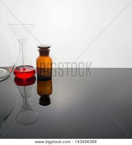 Glassware With Blur Laboratory In Background.