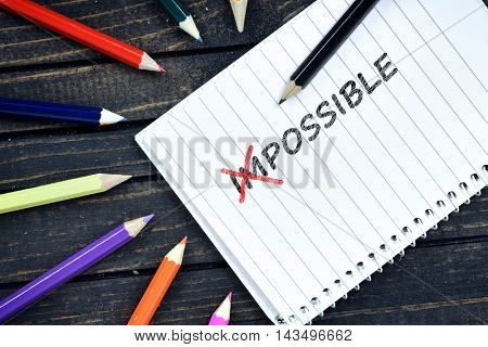 Possible text on notepad and colorful pencils