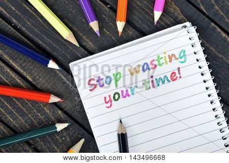 Stop wasting your time text on notepad and colorful pencils