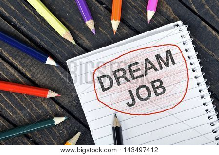 Dream Job text on notepad and colorful pencils