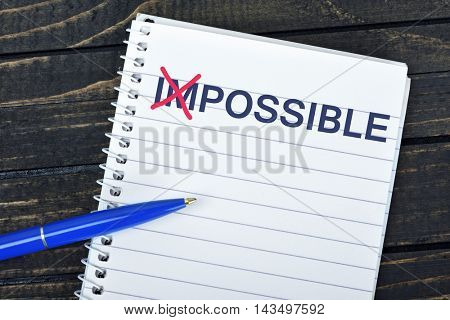 Possible text on notepad and blue pen