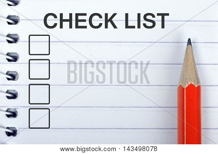 Check list on notepad and red pencil
