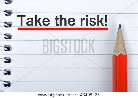 Take the risk text on notepad and red pencil