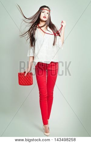 Fashion photo of young magnificent woman. Studio photo