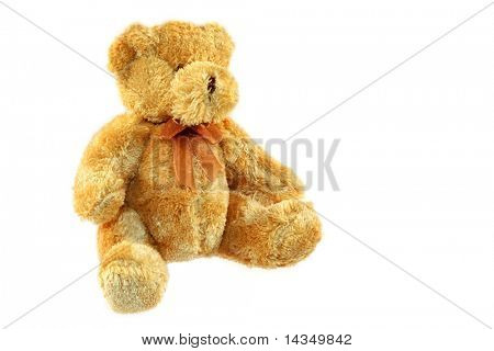 A tiny tan teddy bear, isolated on white.