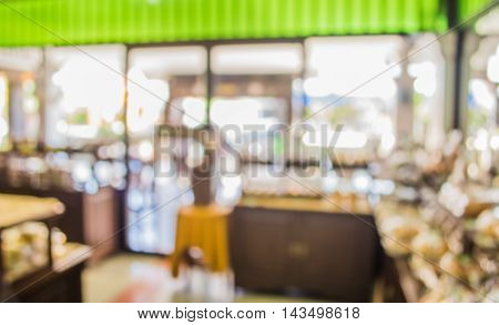 Image Of Blurred Bakery Shelf In Coffee Shop .