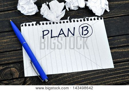Plan B on notepad and crippled paper