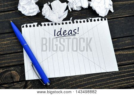 Idea text on notepad and crippled paper
