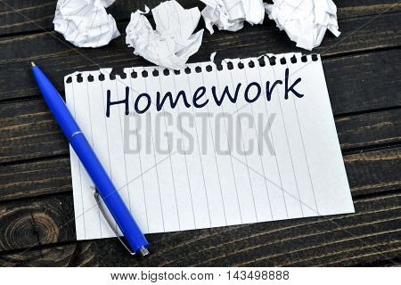 Homework text on notepad and crippled paper