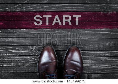 Business man shoes and start word
