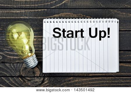 Start up text on notepad and light bulb